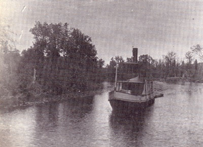 Tugboat on Forested River, circa 1915.