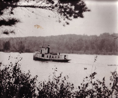The Mike Hauling Tanbark, Magnetawan River, circa 1917.