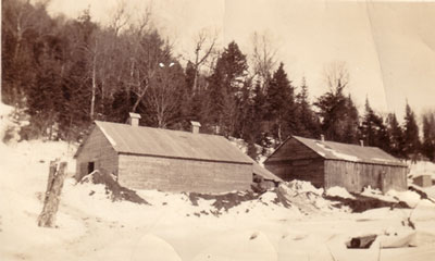 Two Buildings in Logging Camp, circa 1930