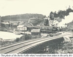 Train Leaving Burk's Falls with a Boat in Dock, circa 1930