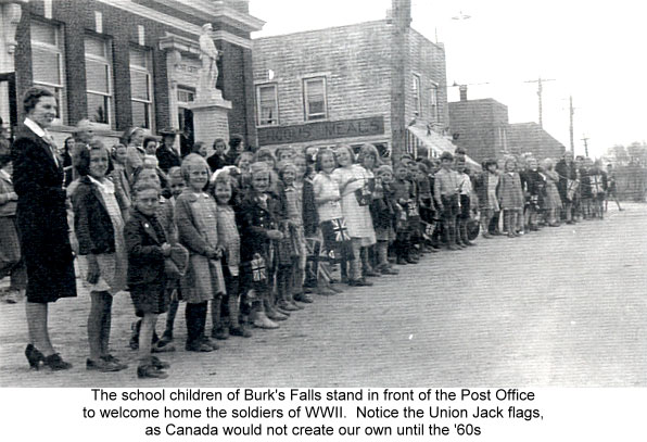 The school children of Burk's Falls stand in front of the Post Office to welcome home the soldiers of WWII. Courtesy the Burk's Falls, Armour & Ryerson Union Public Library.