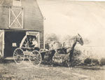 Two People Coming Out of a Barn in a Horse-Drawn Buggy, circa 1920