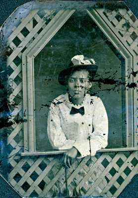 Tintype of Girl Peering through Lattice [n.d.]