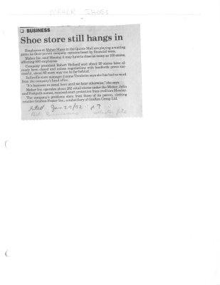 Shoe store still hangs in