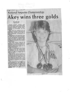 Akey wins three golds