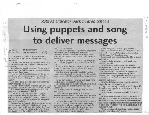 Using puppets and song to deliver messages
