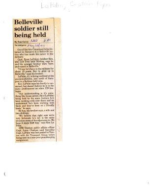 Belleville soldier still being held