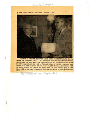 George E. Grenke receives long service certificate
