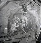 Diamond drill under ground at iron mine, Atikokan, Ont.