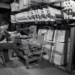 Photo of a worker working on a set of piano keys