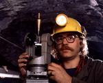 Ontario: Red Lake- gold mine engineer, Larry Sletmoen, underground with transit