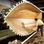 Ontario: Penetanguishene- fibreglassing a hull at Grew boat works