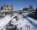 Ontario: Ottawa - frozen - over Rideau Canal is skaters paradise Parliament Hill and Ottawa Convention Centre in background