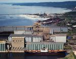 Ontario: Thunder Bay - grain elevators with paper mill in distance