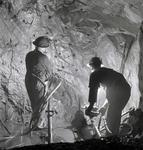 Photograph of men in mine