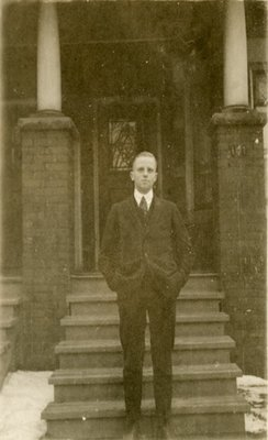 Dr. George C.R. Hall Standing by Residence