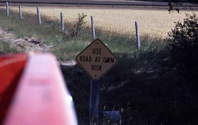 """Use at own risk"" sign, unknown location"