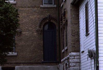 Door with transom, brick work, unknown location