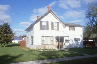 White, 1.5 storey house
