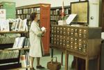 Interior of Carnegie library, fiction section and card catalogue, 1975