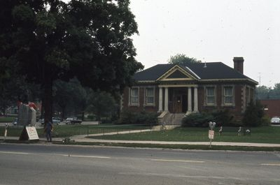 Exterior of Carnegie library, front view from street, including east side, 1973