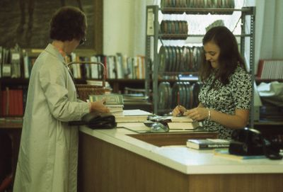 Interior of Carnegie library, checkout desk, 1973