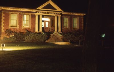 Exterior of Carnegie library, front at night, 1973