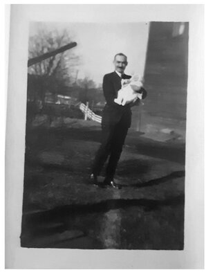 Man with child, date unknown