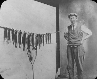 Man with a display of his fishing net and catch