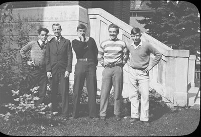 Portrait of a group of young men in front of Colborne High School