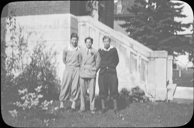 Portrait of three young men in front of Colborne High School