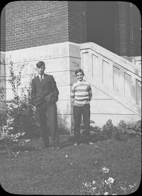 Portrait of two young men in front of Colborne High School