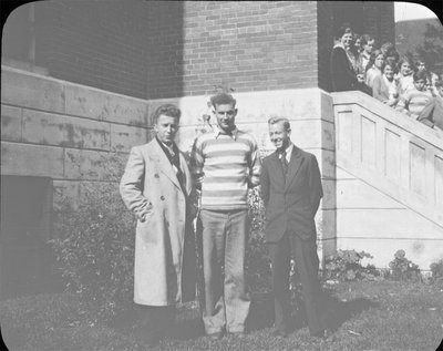 Portrait of Jack Armstrong (left), Bill Griffis (right) and another young man (centre) in front of Colborne High School