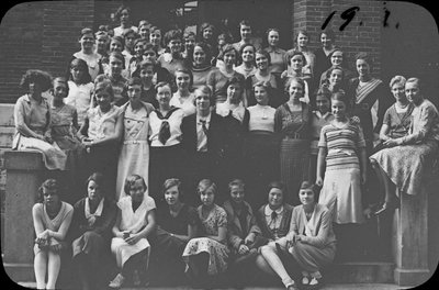 Portrait of a group of young women on the steps of Colborne High School, 1920s[?]