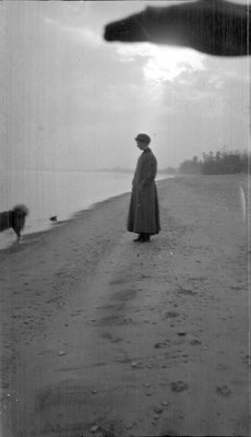 Woman standing in profile at the shoreline