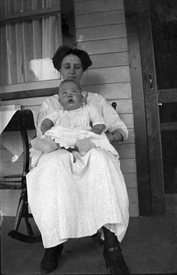 Mother and child resting on a porch
