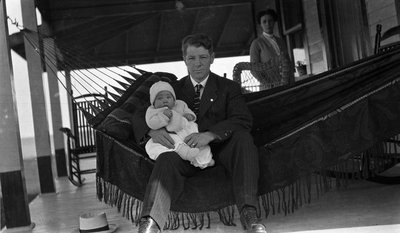 A young couple and baby at Griffis' summer home
