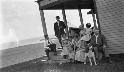 Photograph of family at the Griffis' summer home, Colborne, Cramahe Township
