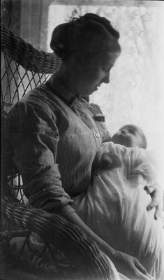 Griffis family photo of mother and baby in front of a window