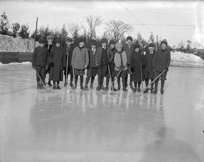 A group of young hockey players at an outdoor rink