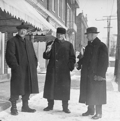 James McGlennon (centre) and two other gentlemen in front of Custom House, Colborne