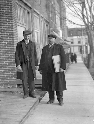 Abraham Gould, town clerk, and Chief Jamieson standing on King St., Colborne