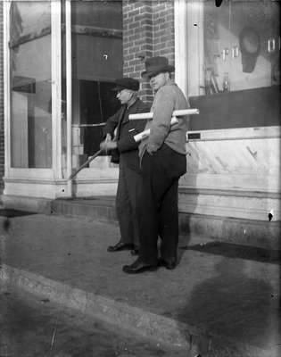 Two men standing in front of the Post Office, Colborne