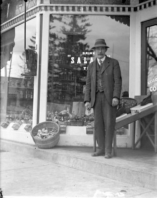 Charles Brown? in front of W.H. Edwards Grocery Store, Colborne