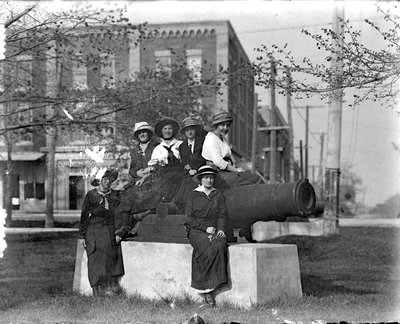 Six unidentified women pose with the cannon, Victoria Park, Colborne