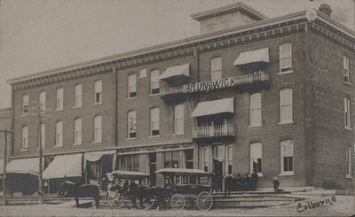 Horse drawn livery coaches in front of the Brunswick Hotel, Colborne, Postcard