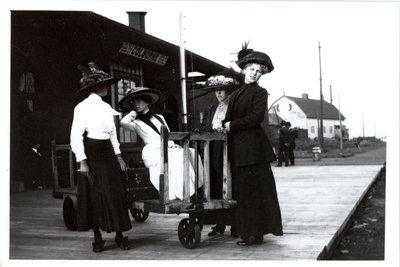 Colborne women modelling Miss Culver's hats at the Grand Truck Railway Station, Colborne