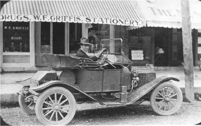 Photograph of Frank Griffis in front of W. F. Griffis Drug Store, Colborne, Cramahe Township