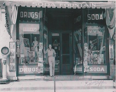 Photograph of Bill Griffis in front of Griffis Drug Store, Colborne, Cramahe Township
