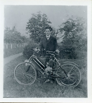 Postcard of a young man with motorized bicycle